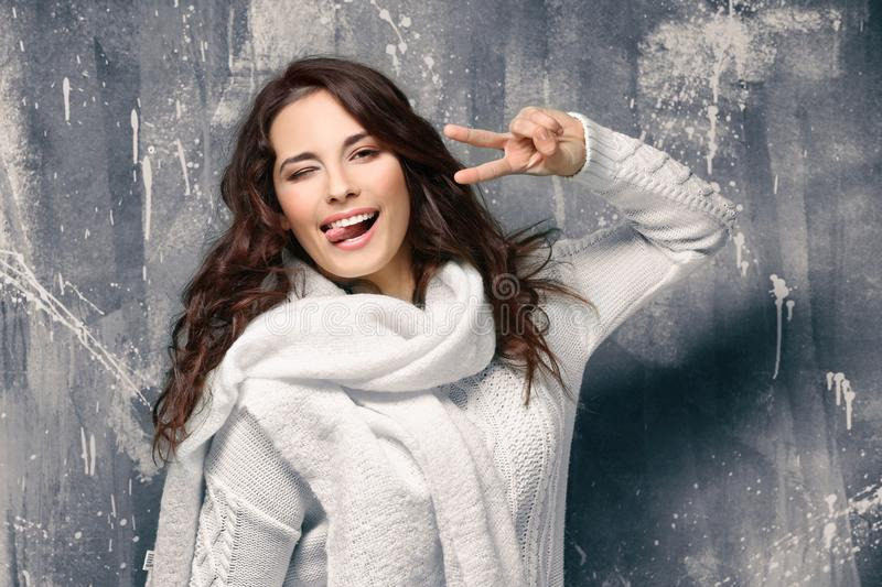 Beautiful young woman in warm sweater stock photography