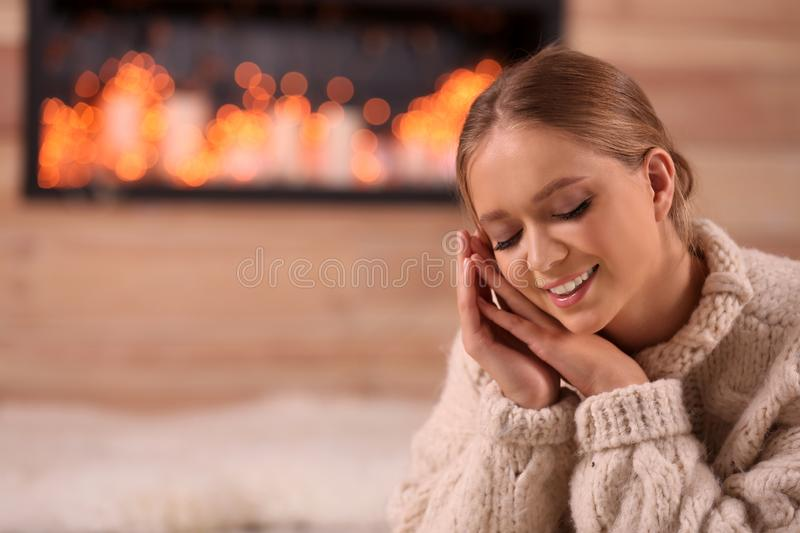 Beautiful young woman in warm sweater, space for text. Winter season. Beautiful young woman in warm sweater at home, space for text. Winter season royalty free stock images