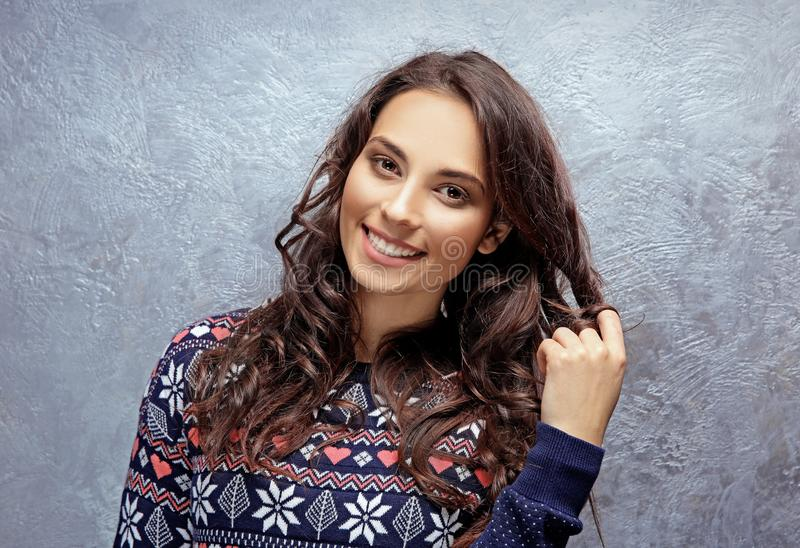 Beautiful young woman in warm sweater royalty free stock photography