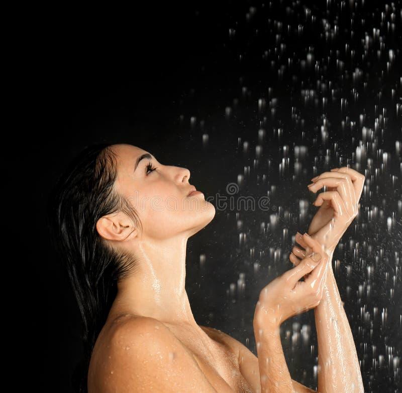 Beautiful young woman washing body royalty free stock photo