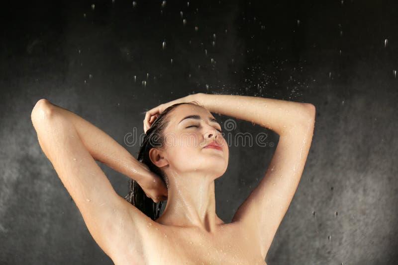 Beautiful young woman washing body stock images