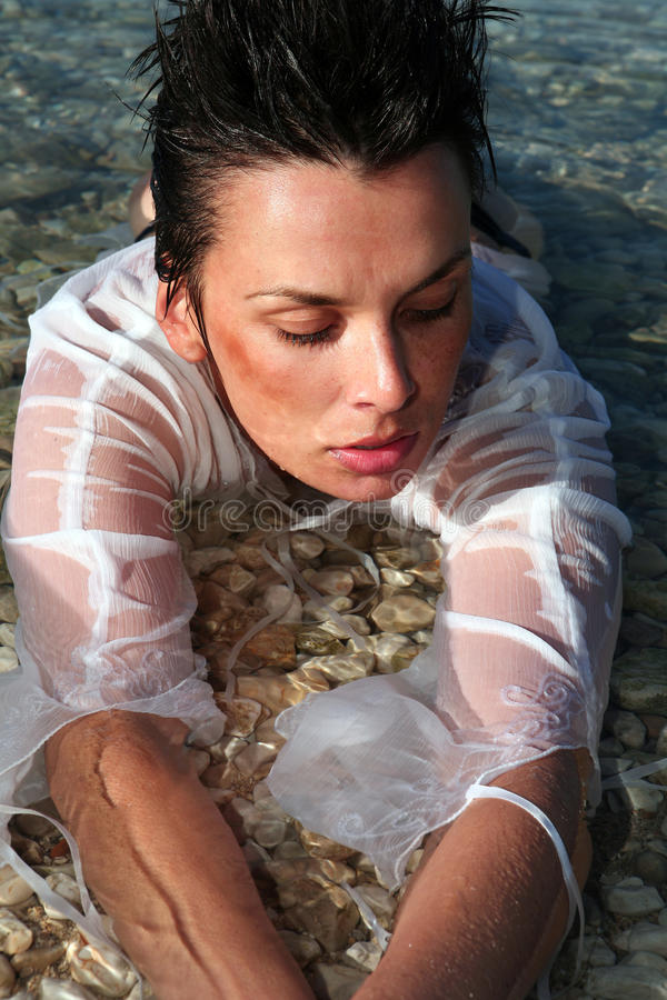 Beautiful young woman in water stock image