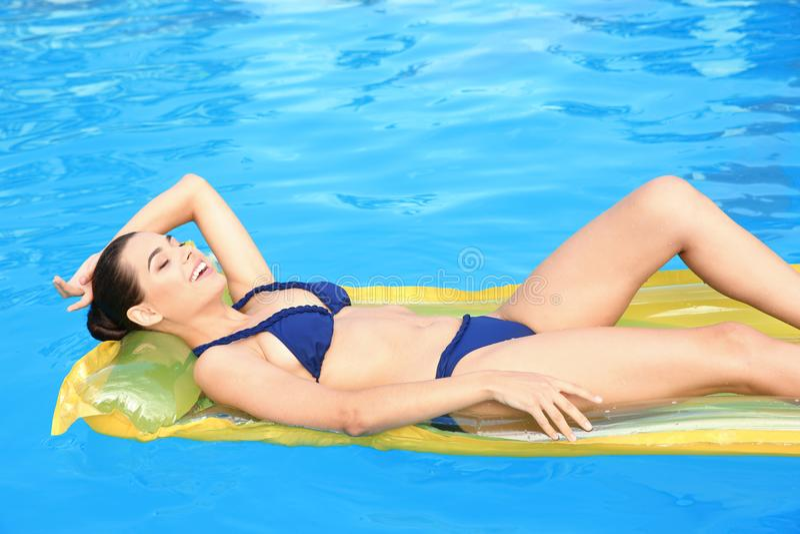 Beautiful young woman wearing bikini royalty free stock photography