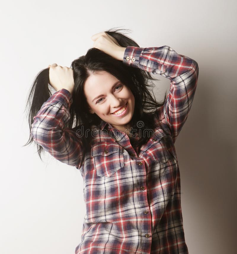 Woman wearing casual clothes, posing on white background. Beautiful young woman wearing casual clothes, posing on white background stock photos