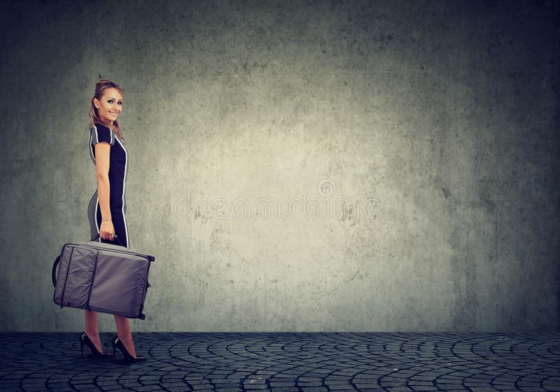 Beautiful young happy woman with suitcase ready to travel stock images