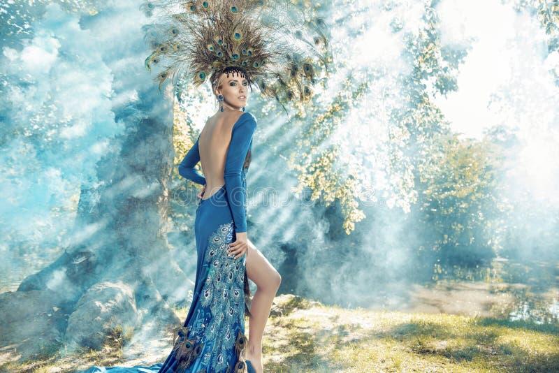 Beautiful young woman wearing a fabulous dress stock image
