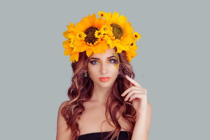 Beautiful young woman wearing floral headband royalty free stock photo