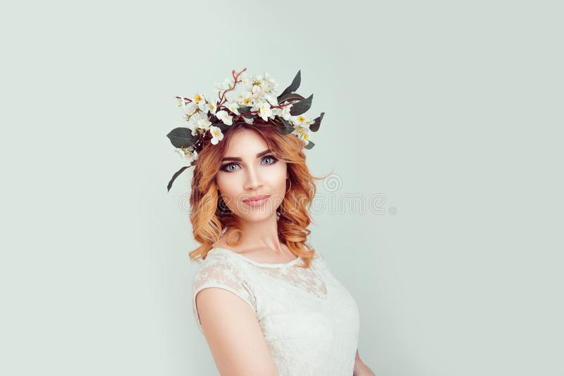 Beautiful young woman wearing floral headband stock photography