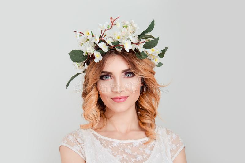 Beautiful young woman wearing floral headband smiling slightly stock photos