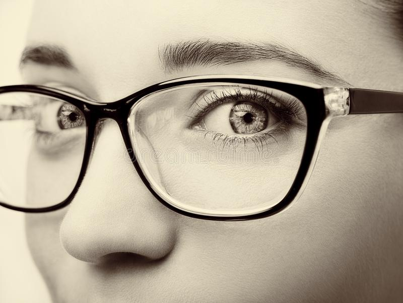 Beautiful young woman wearing glasses close-up on white background. royalty free stock images