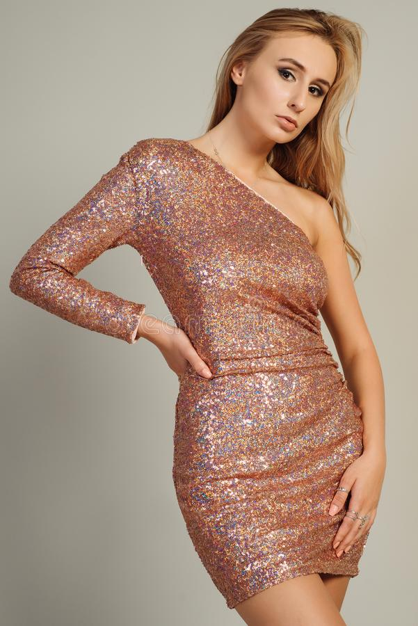 Beautiful young woman wearing sequined evening dress royalty free stock photos