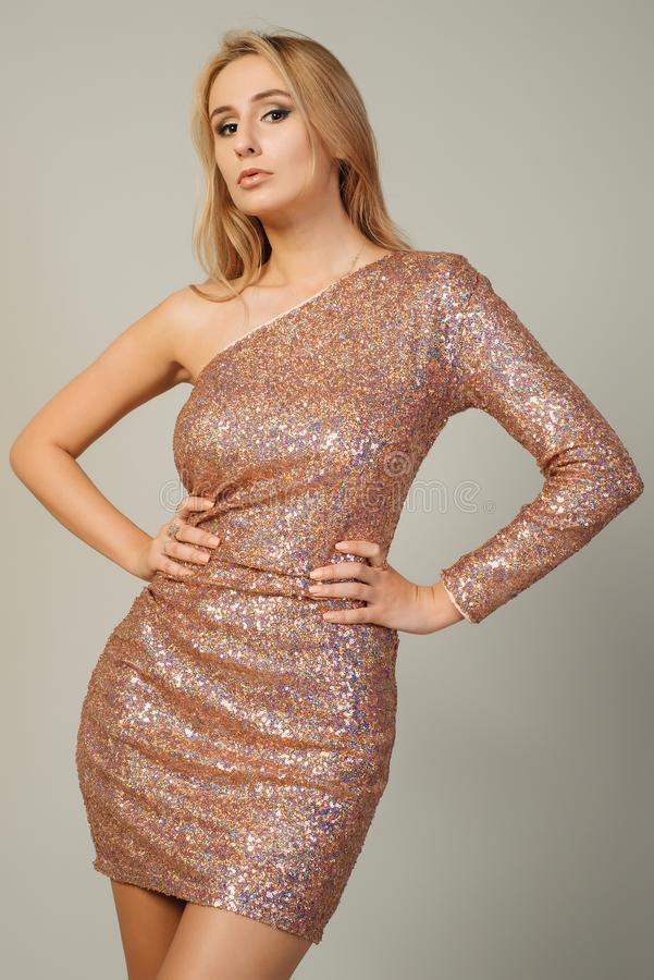 Beautiful young woman wearing sequined evening dress stock photos
