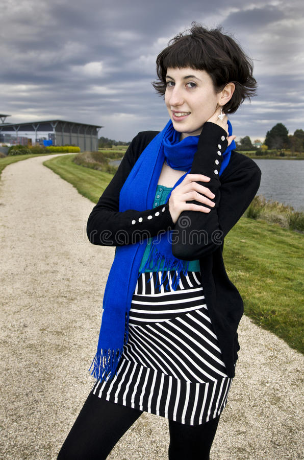 Beautiful Young Woman Wearing Striped Skirt Royalty Free Stock Photos