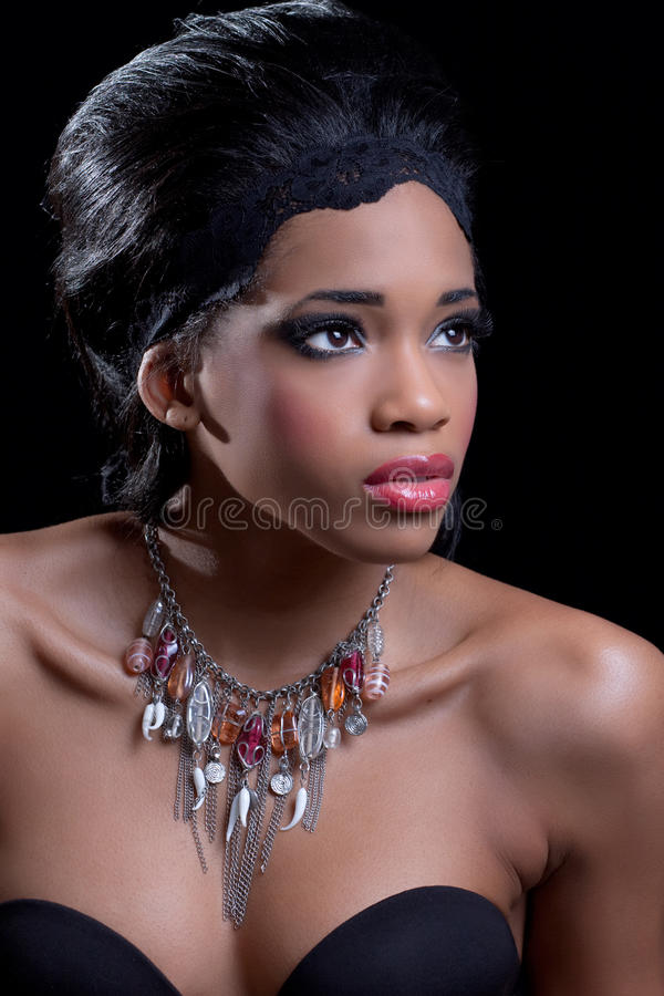 Beautiful young woman wearing stylish necklace royalty free stock photo