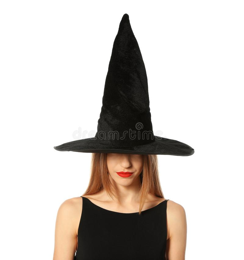 Beautiful young woman wearing witch costume for Halloween party royalty free stock images