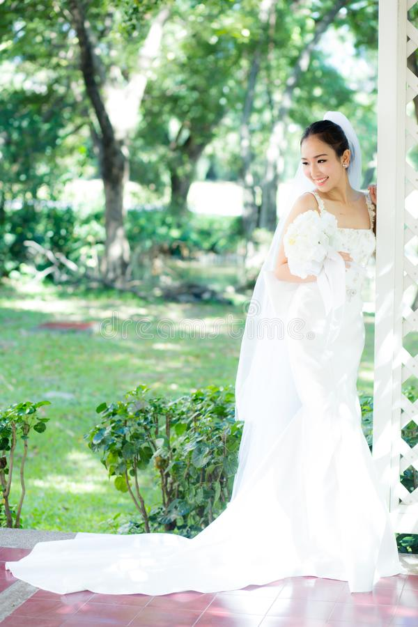 Beautiful Young Woman On Wedding Day In White Dress In The Garden ...