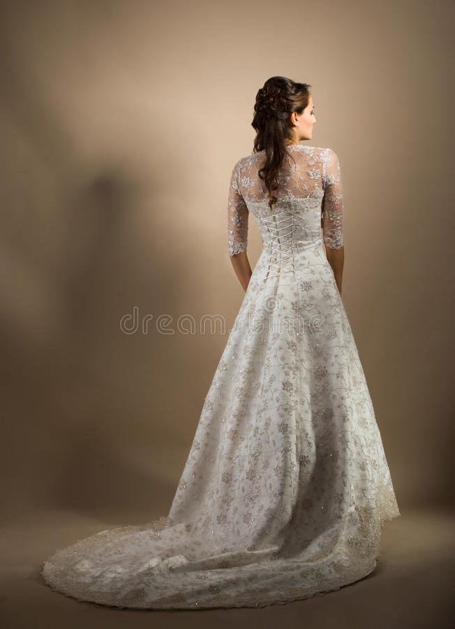 The beautiful young woman in a wedding dress royalty free stock photography
