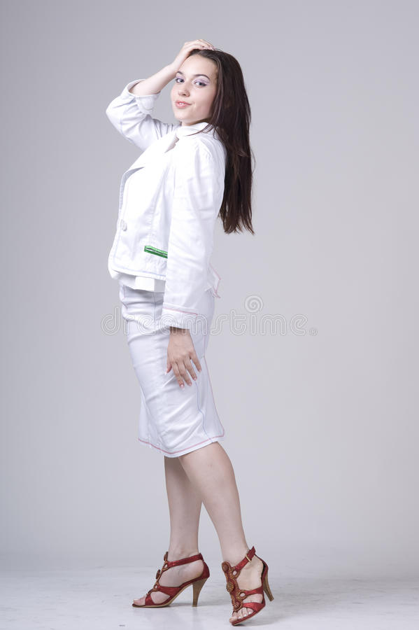 Beautiful young woman in white royalty free stock photo