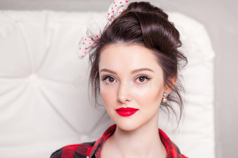 Beautiful young woman on white background in old fashion clothes representing pinup and retro style stock photos