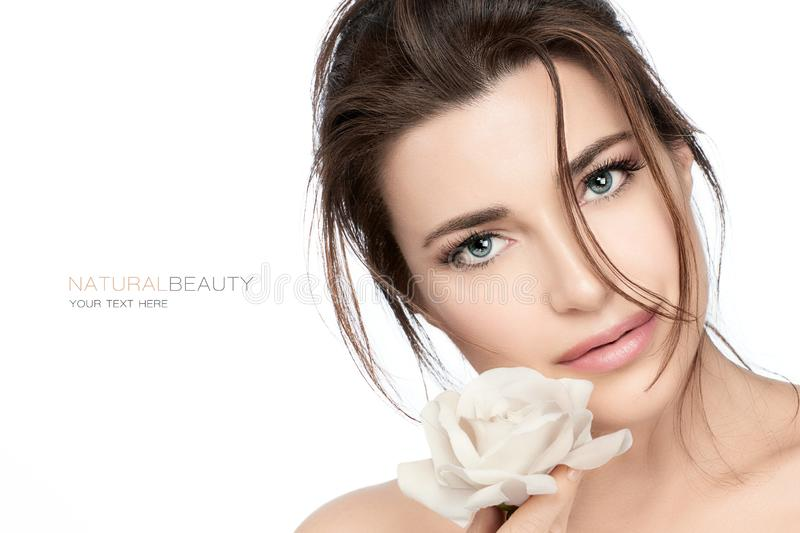 Beautiful young woman with white rose. Skincare and healthy cosmetology concept stock photos