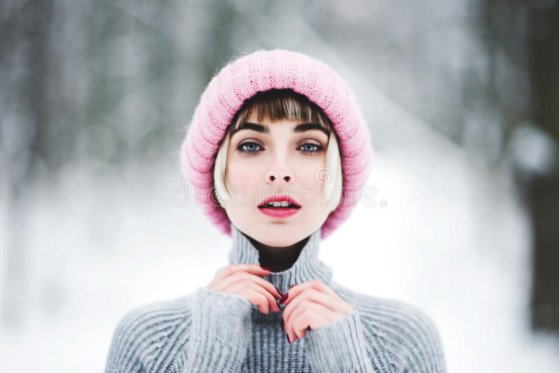 Beautiful young woman in winter forest stock images