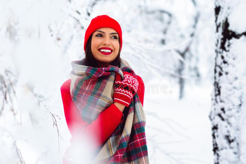 Portrait of young beautiful woman in winter time - Image. Beautiful young woman in winter park - Image stock photo