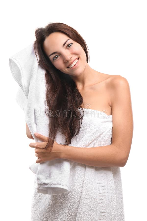 Beautiful young woman wiping hair with towel after shower on white background stock image