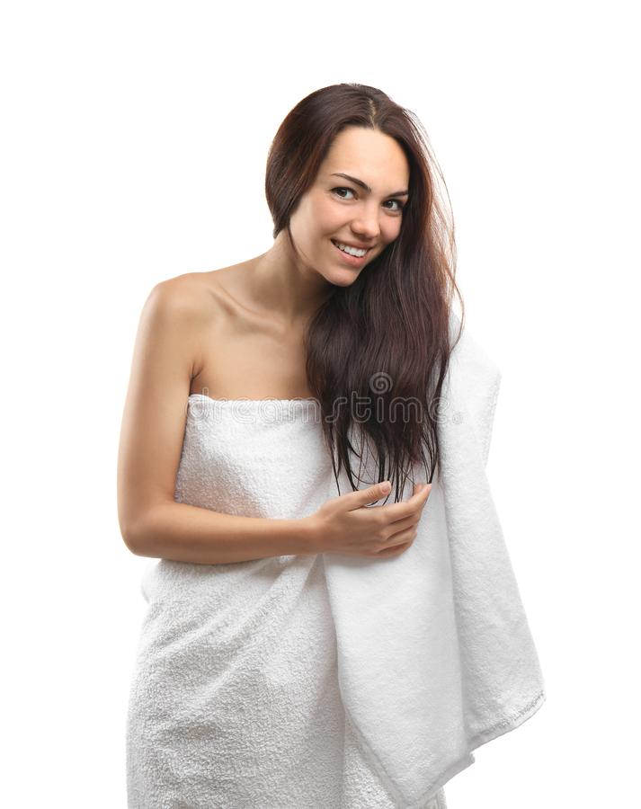 Beautiful young woman wiping hair with towel after shower on white background stock images