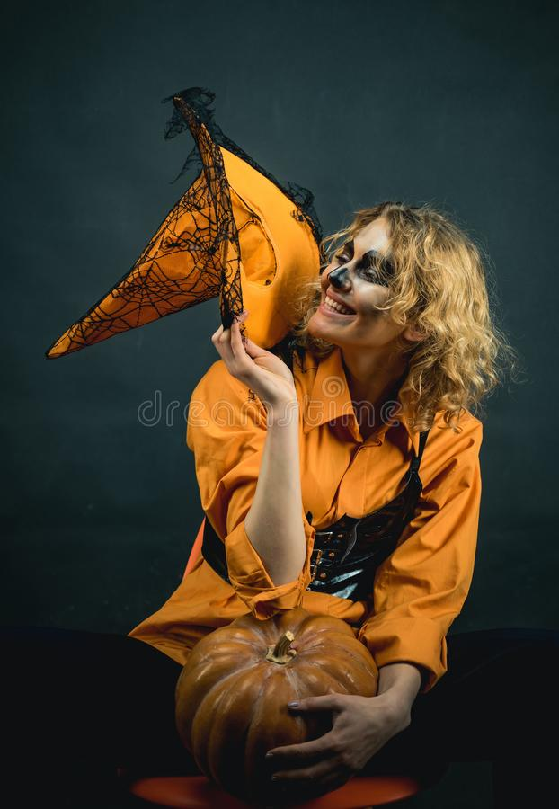 Beautiful young woman in witches hat with bright Halloween makeup. Sexy girl in Halloween costume. Halloween Witch. stock images