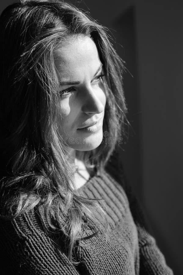Beautiful young woman in woolen sweater enjoying stock photo