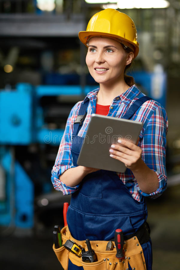 Beautiful Young Woman Working at Factory stock photography