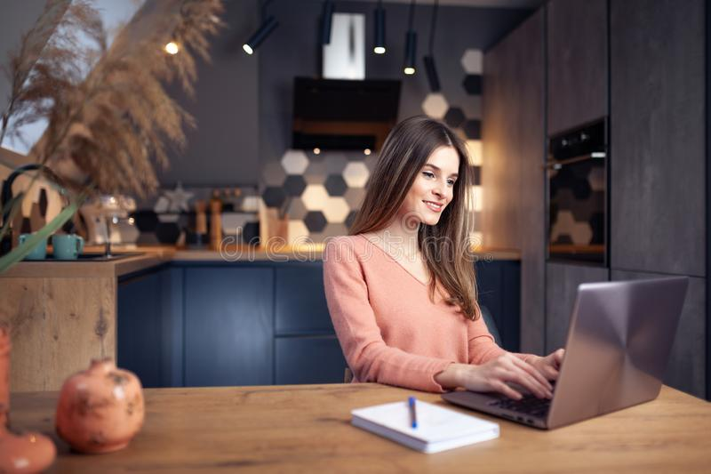 Beautiful young smiling woman working from home stock images
