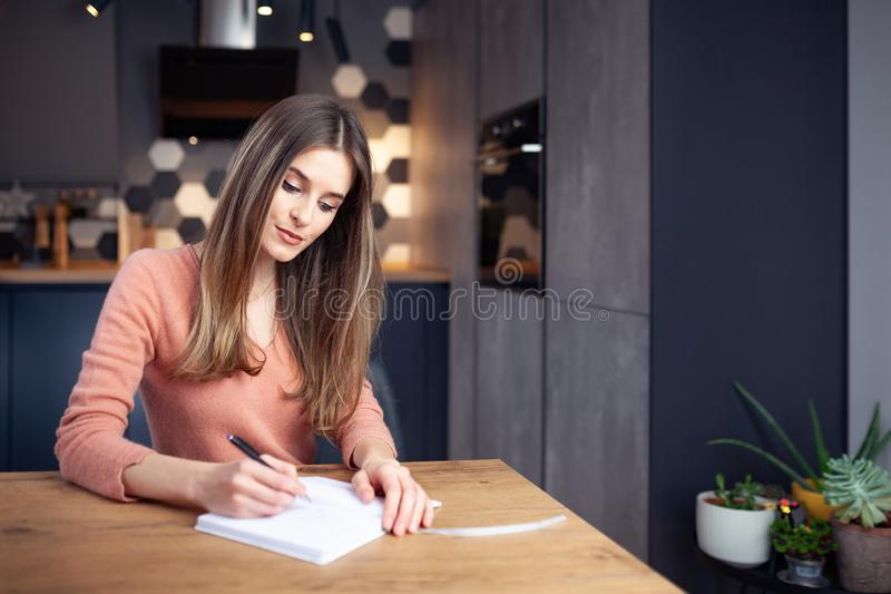 Beautiful young smiling woman working from home royalty free stock image