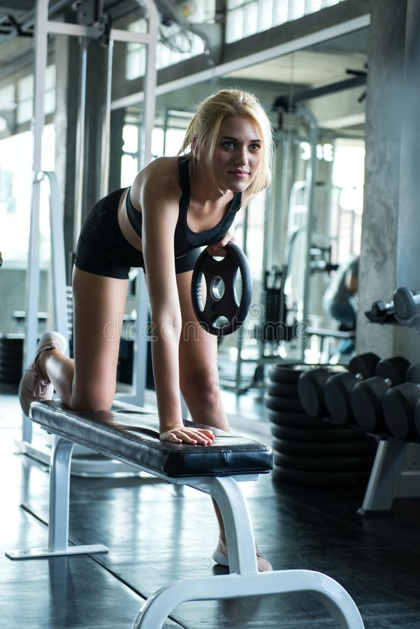 A beautiful young woman smile and training with dumbbell stock photography