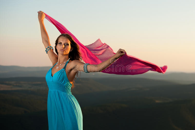 Beautiful young woman wtih red scarf stock image