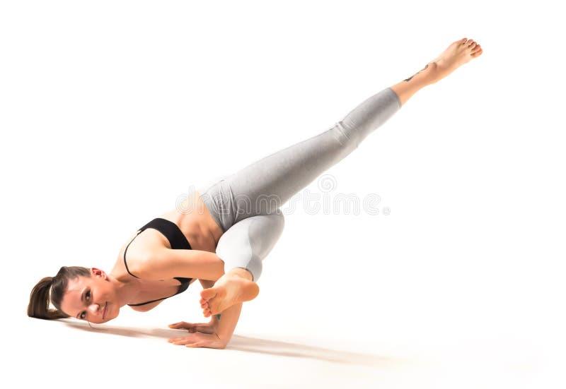 Beautiful young woman yoga teacher royalty free stock photography