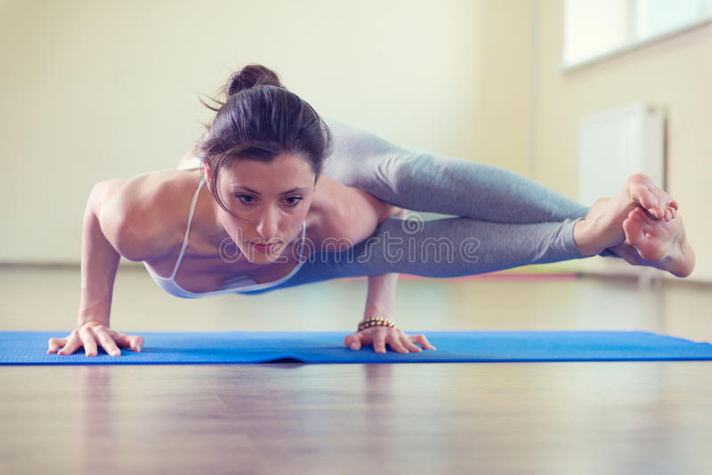 Beautiful young woman yoga workout stock image
