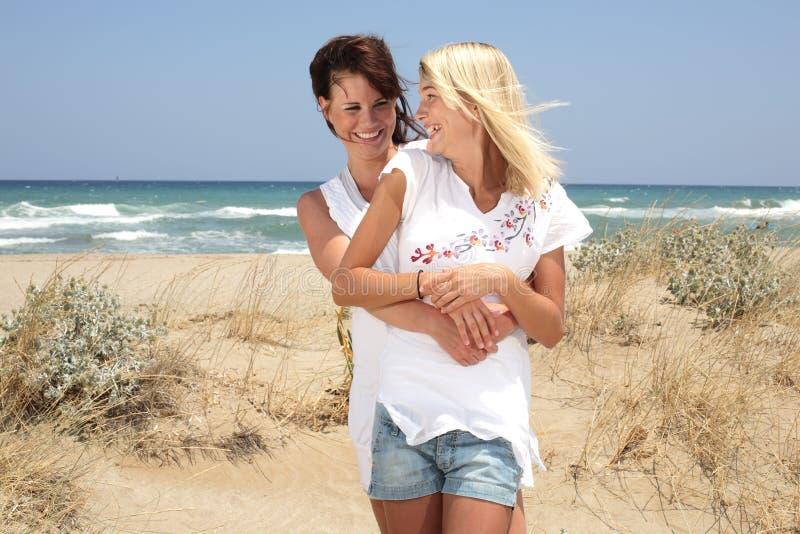 Beautiful young women on the beach. Beautiful young women having fun on the beach royalty free stock photo