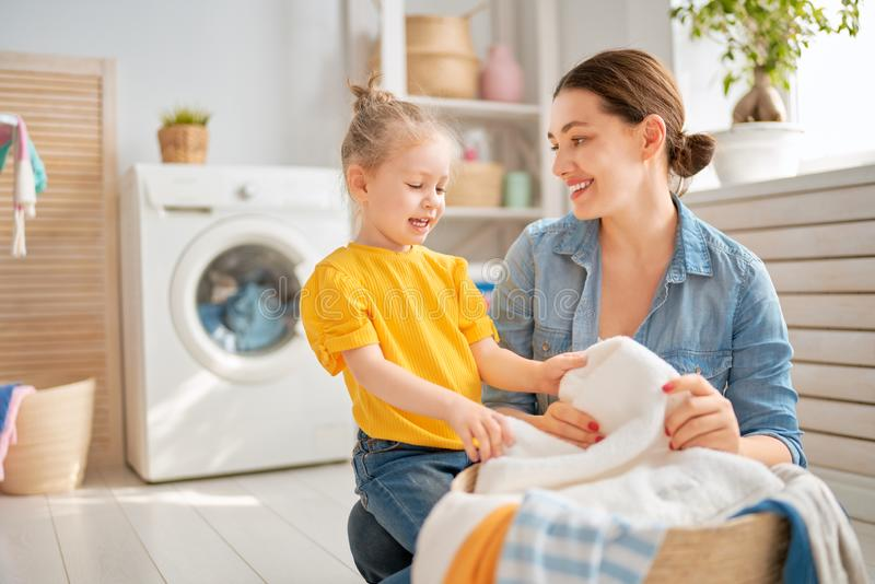 Family doing laundry stock images