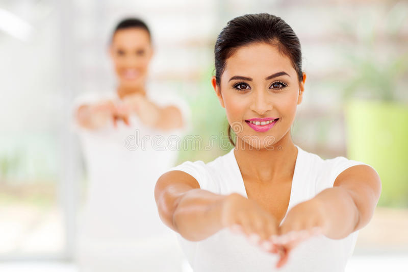 Young women stretching stock image