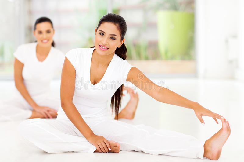 Women stretching exercise stock photography