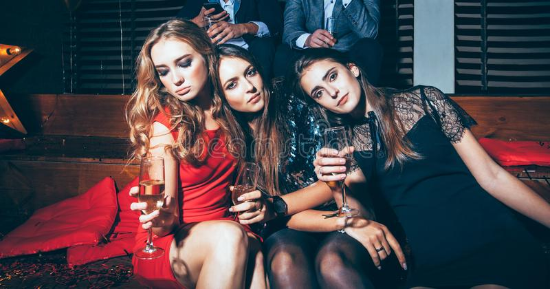 Beautiful young women enjoying party and having fun at night club stock images