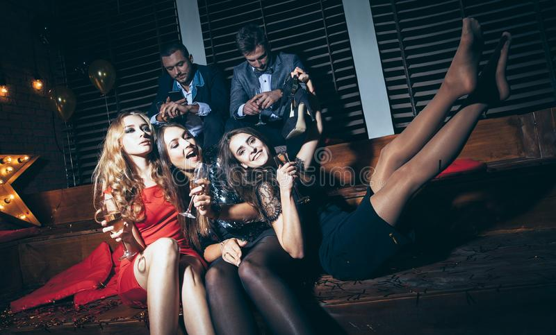 Beautiful young women enjoying party and having fun at night club. New year, Birthday, Holiday Event concept stock photo