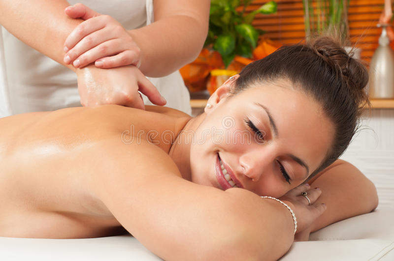Beautiful young women getting a massage stock images