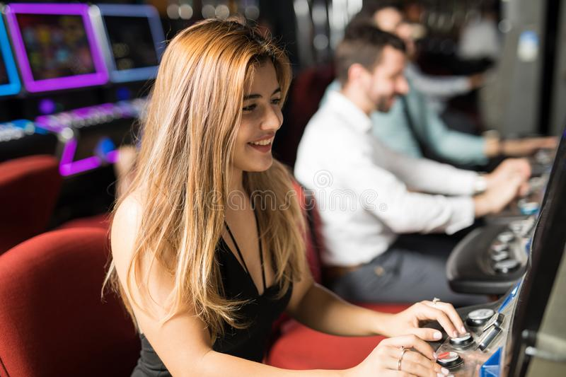 Young woman having fun in a casino royalty free stock image