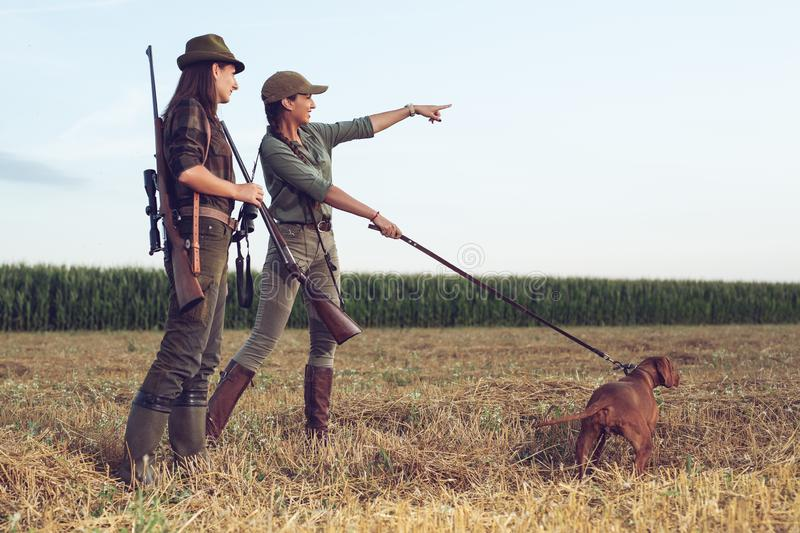 Women hunters with hunting dog royalty free stock photo