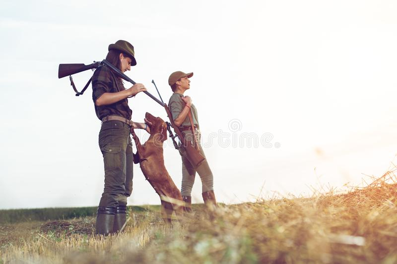 Women hunters with hunting dog stock photography
