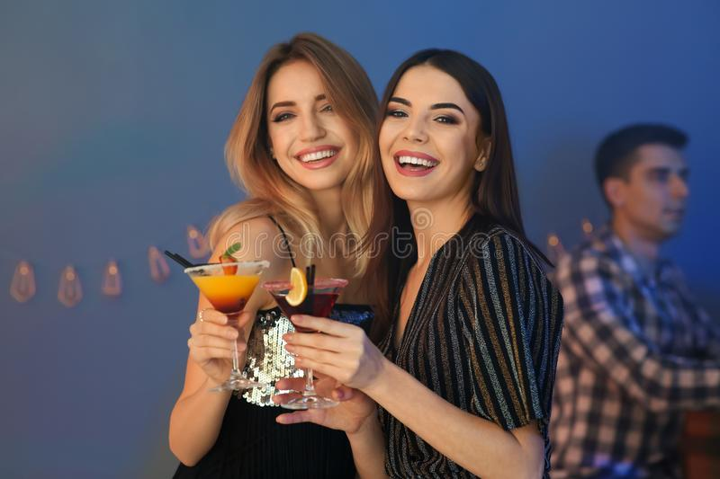 Beautiful young women with martini cocktails. In bar royalty free stock photos