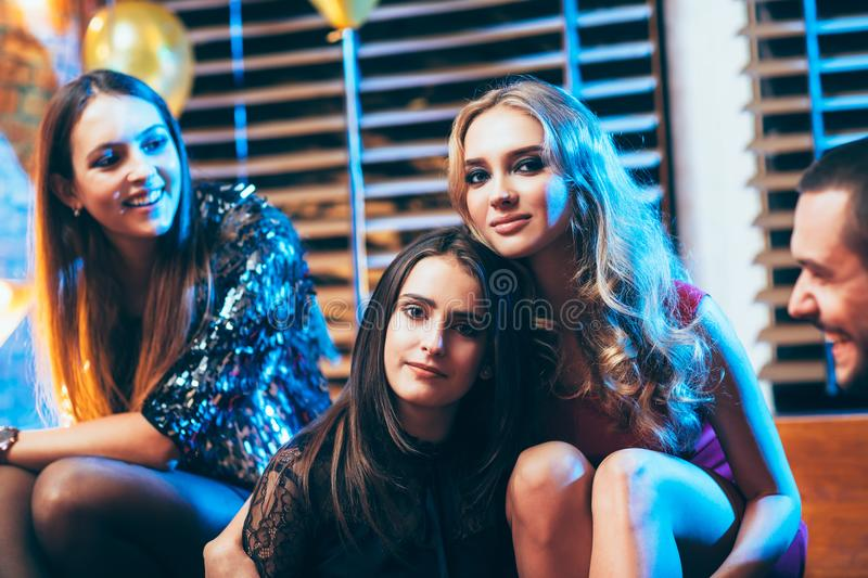 Beautiful young women on party event. Friends enjoying holidays. New year, Birthday, Holiday Event concept royalty free stock photography