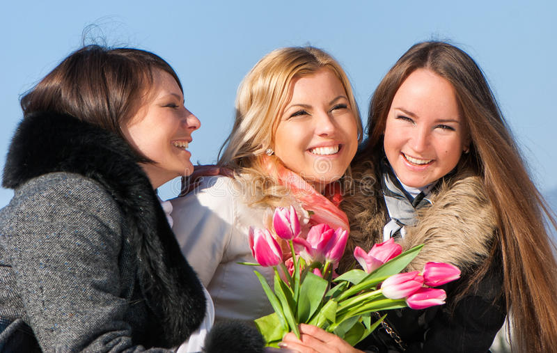 Beautiful young women with pink tulips royalty free stock photo